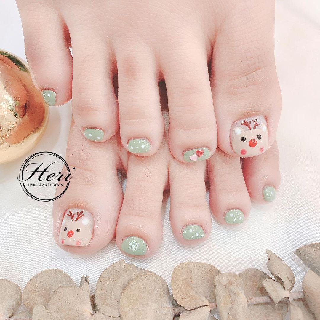 Hưởng ứng Noel bằng những mẫu nail có họa tiết nổi bật và độc đáo - Ảnh 17.