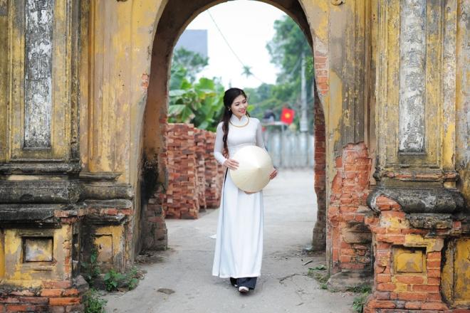 Dịp Tết Dương lịch, chụp ngay bộ ảnh áo dài thướt tha tại 5 địa điểm nổi tiếng ở Hà Nội - Ảnh 13.