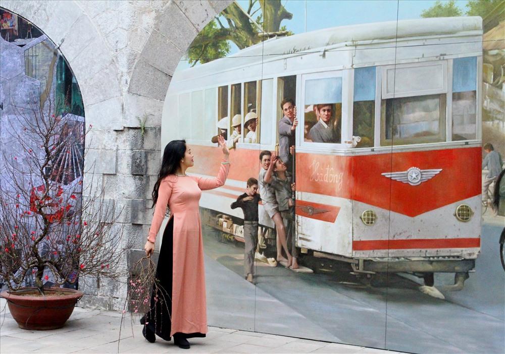 Dịp Tết Dương lịch, chụp ngay bộ ảnh áo dài thướt tha tại 5 địa điểm nổi tiếng ở Hà Nội - Ảnh 7.