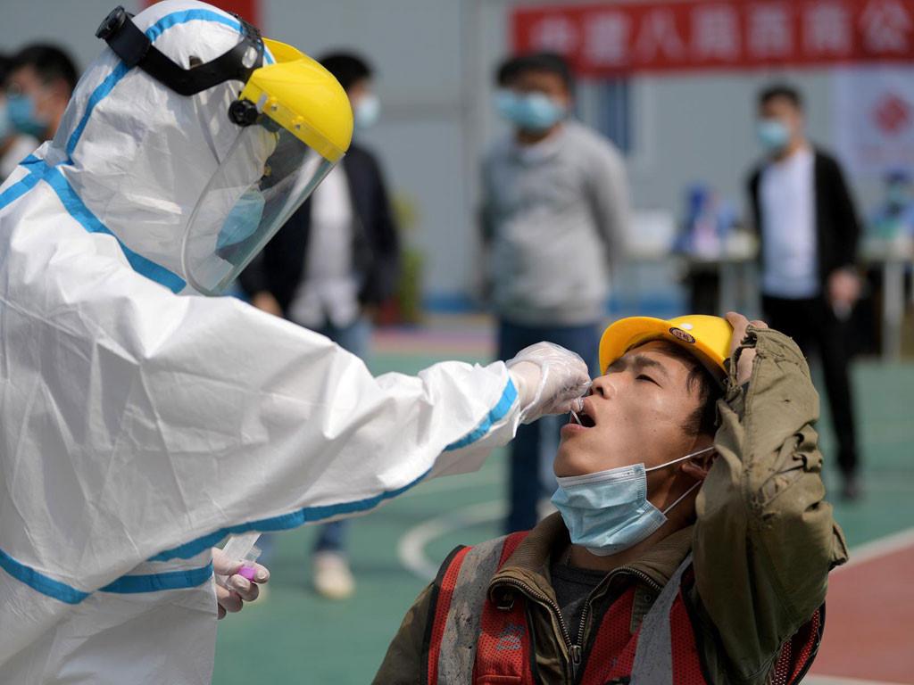 Trung Quốc trước áp lực bị kiện vì Covid-19 - Ảnh 1.
