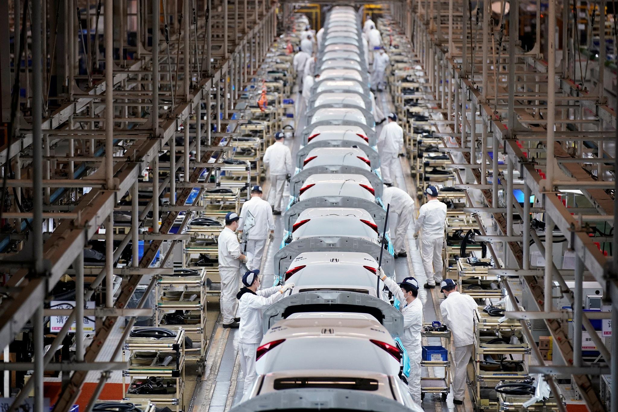 Nhà máy Trung Quốc đã trở lại nhưng khách hàng của họ thì không - Ảnh 1.