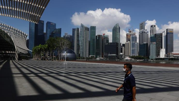 Thị trường cho thuê văn phòng châu Á chật vật giai đoạn tái mở cửa kinh tế do dịch Covid-19 - Ảnh 1.