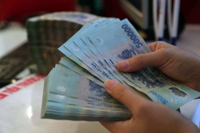 Cần vay tiền, chọn ngân hàng hay công ty tài chính? - Ảnh 1.