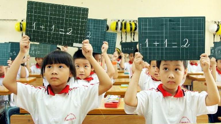 Học sinh tiểu học được miễn học phí từ 1/7 - Ảnh 1.