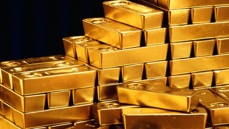 Giá vàng tụt xuống dưới 2.000 USD/ounce - Ảnh 1.
