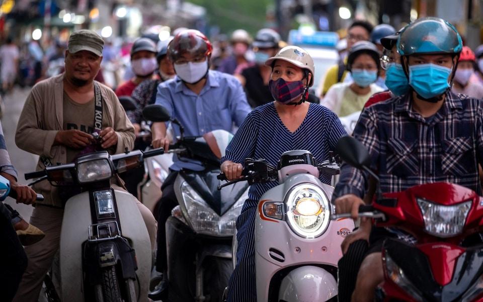 Việt Nam được báo quốc tế ca ngợi về cách đè bẹp làn sóng COVID-19 thứ hai - Ảnh 2.