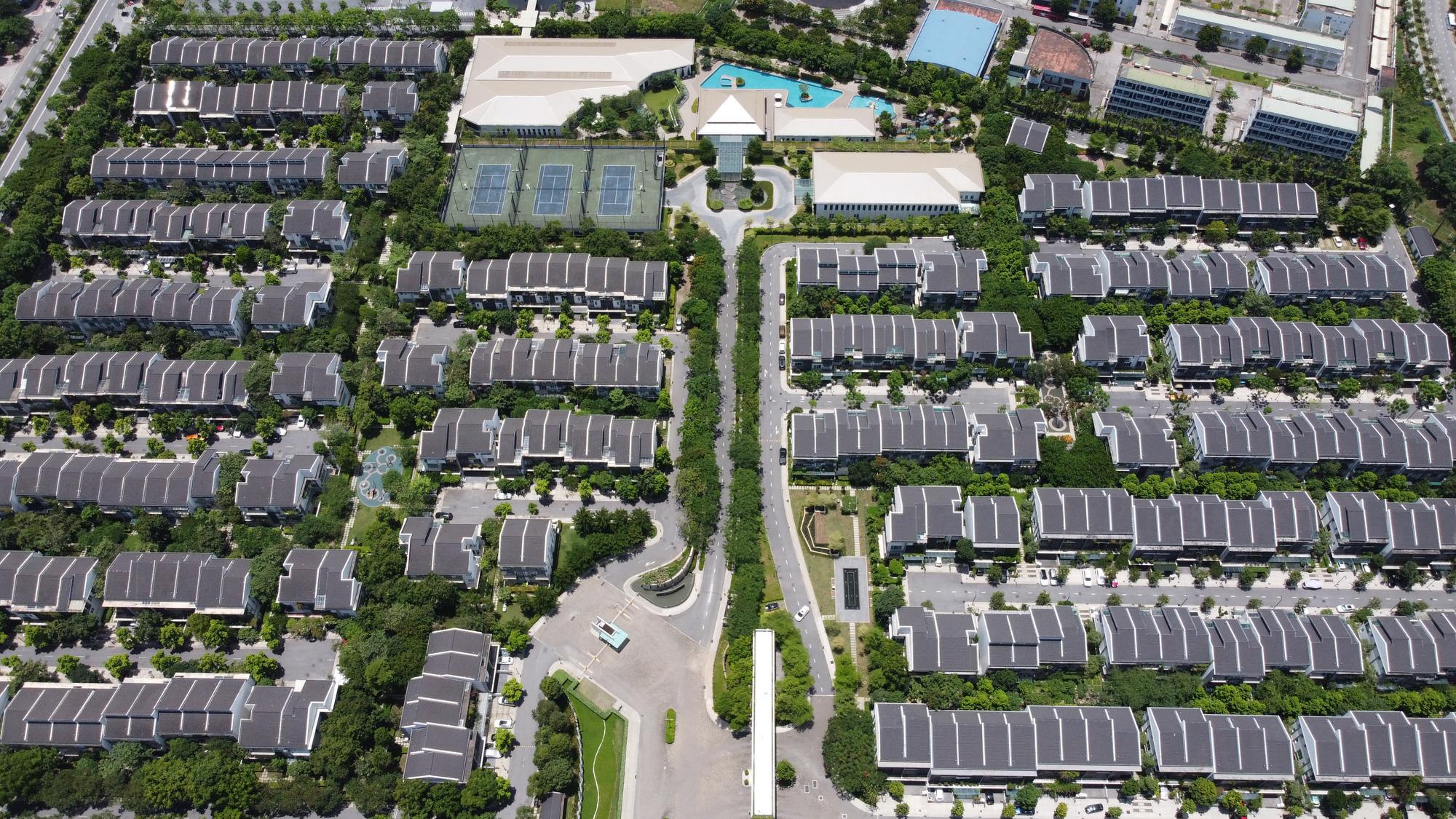 Bộ Xây dựng đề xuất sửa 2 luật tác động lớn đến thị trường bất động sản - Ảnh 1.