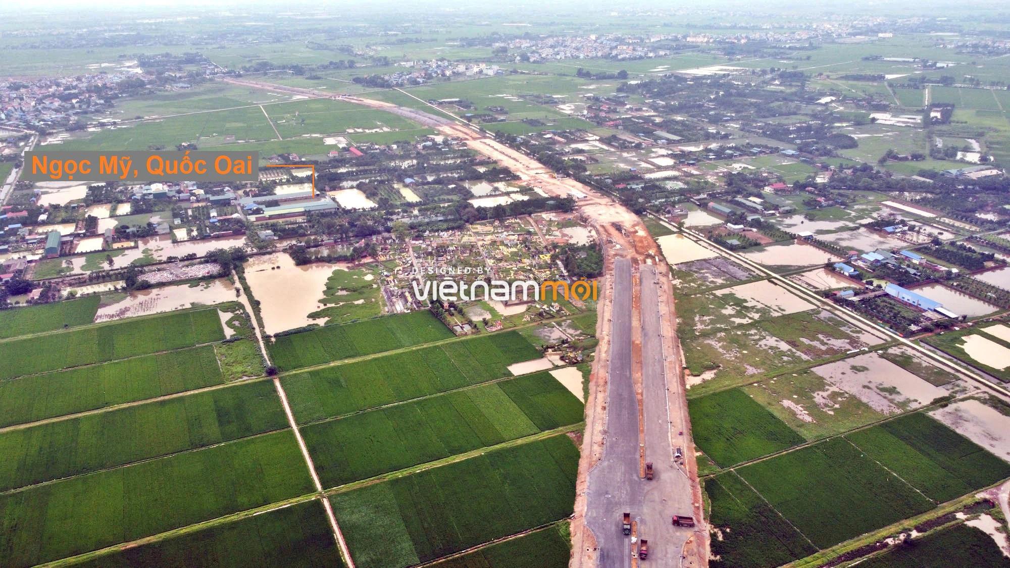 Toàn cảnh đường trục chính Bắc - Nam KĐT Quốc Oai kéo dài đang mở theo quy hoạch ở Hà Nội - Ảnh 5.