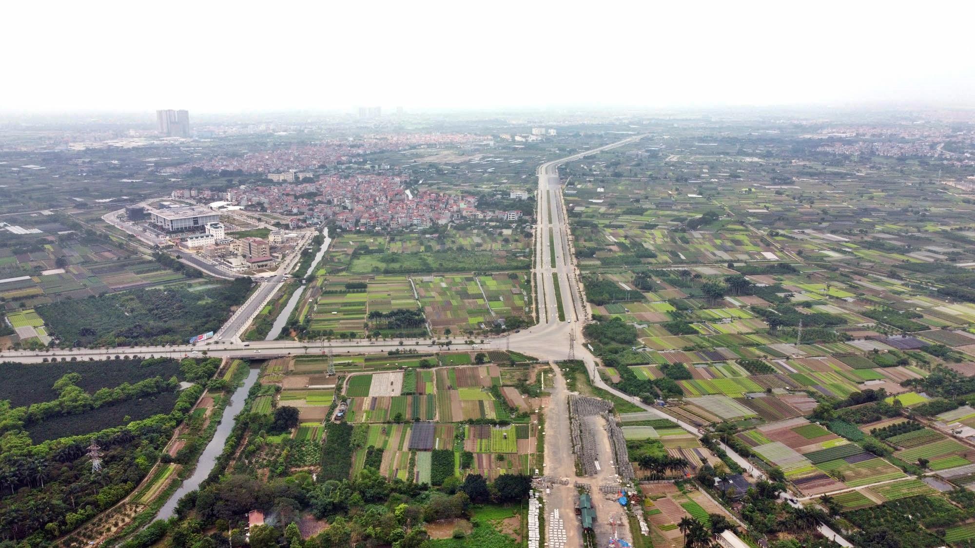 Toàn cảnh đường Tây Thăng Long đang mở theo quy hoạch ở Hà Nội - Ảnh 1.