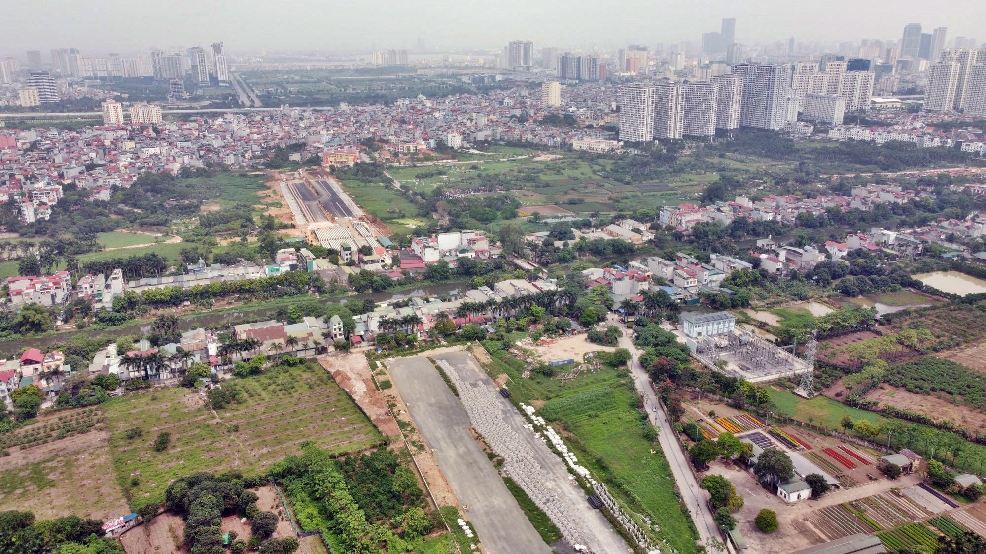 Toàn cảnh đường Tây Thăng Long đang mở theo quy hoạch ở Hà Nội - Ảnh 13.