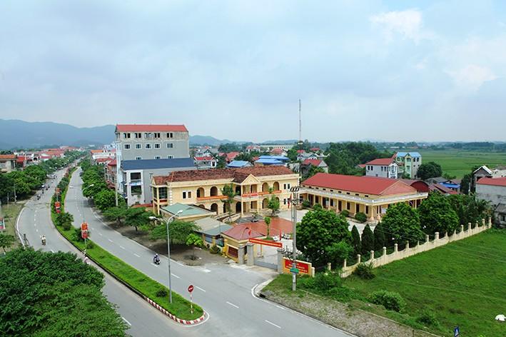 Huyện Sóc Sơn đạt chuẩn nông thôn mới, dần tiến tới hiện thực hóa đô thị vệ tinh  - Ảnh 1.