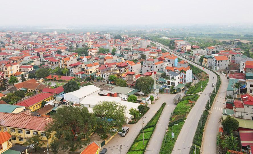 Đẩy mạnh xây dựng nông thôn mới gắn với phát triển đô thị: Tạo bước đột phá lớn - Ảnh 1.