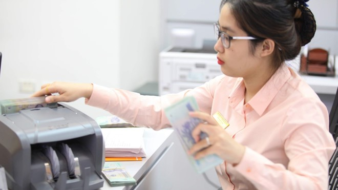 Thống đốc Lê Minh Hưng: 53.000 tỉ chảy vào BOT có nguy cơ phát sinh nợ xấu - Ảnh 1.