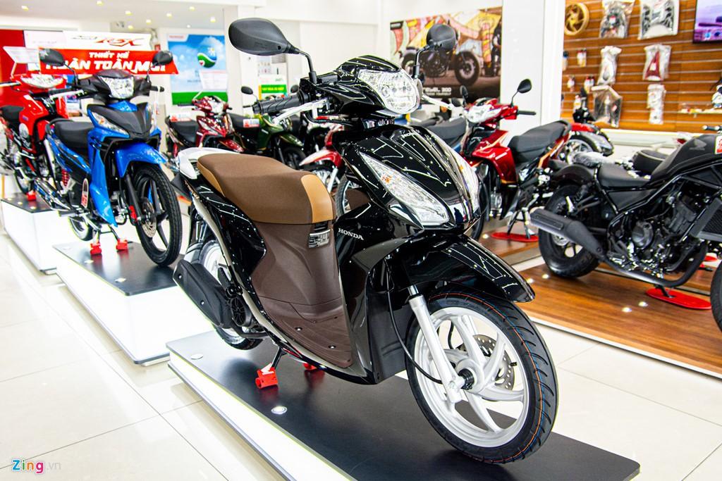 Honda Vision phiên bản mới về đại lí, chênh giá hơn 2 triệu - Ảnh 1.