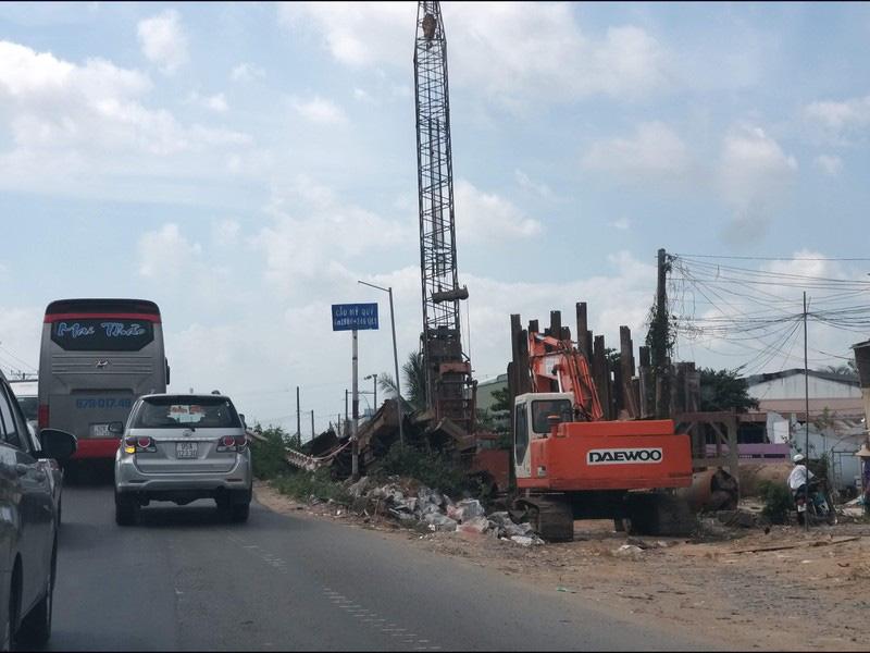 'Tháo' 4 nút thắt cổ chai quốc lộ 1 qua Tiền Giang - Ảnh 1.