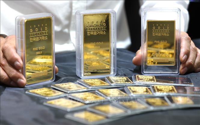 Giá vàng hôm nay 27/12: Vững vàng trên đỉnh cao  - Ảnh 1.