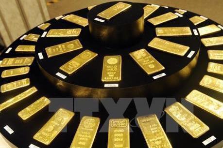 Giá vàng hôm nay 19/3: FED lừng khừng, vàng vọt lên - Ảnh 1.