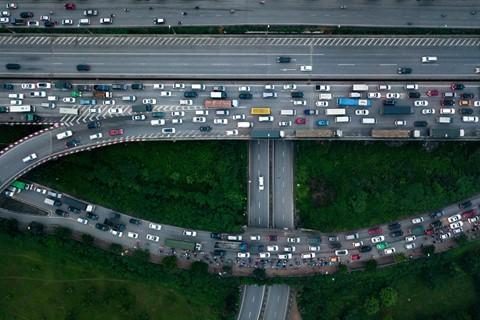 Người dân đội mưa trở lại thành phố, giao thông ùn tắc kéo dài - Ảnh 5.