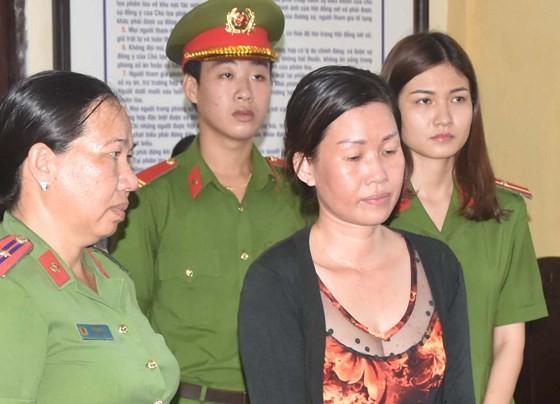 Tố khống cán bộ cướp tài sản, người phụ nữ lĩnh án 3 năm tù - Ảnh 1.