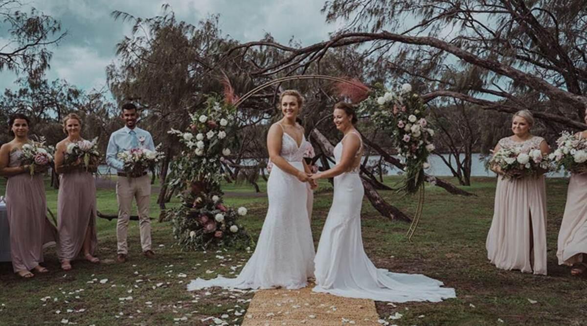 Đám cưới đồng tính ngọt ngào sau 4 năm yêu của cặp nữ vận động viên nổi tiếng - Ảnh 6.