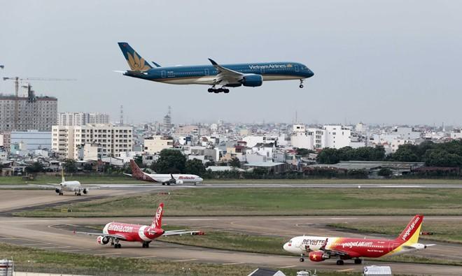 Giá vé máy bay Sài Gòn - Hà Nội đắt nhất là 3,2 triệu đồng - Ảnh 2.