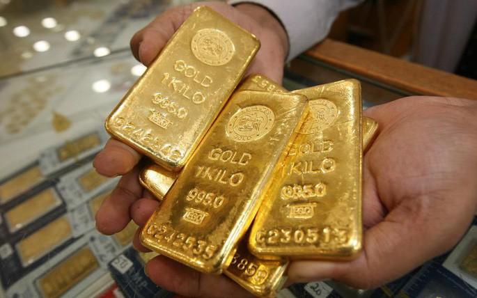 Dự báo giá vàng: Sẽ vọt qua ngưỡng 1.300 USD/ounce?  - Ảnh 1.