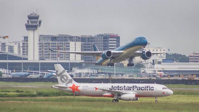 Nhiều thay đổi về phụ phí vé máy bay, hành lí kí gửi sắp được áp dụng - Ảnh 1.