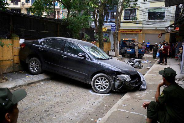 Lái xe Camry lùi chết người ở Hà Nội là một Đại tá Công an - Ảnh 1.