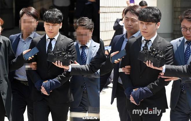 Seungri bị trói và còng tay khi rời tòa án, có thể ở tù 2 - 3 năm - Ảnh 1.