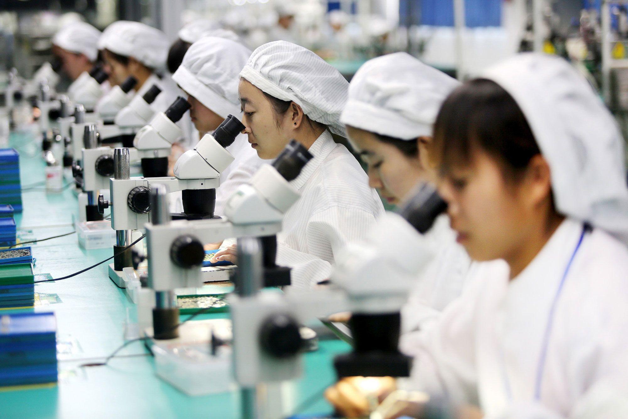 Apple, Intel chao đảo trước cuộc chiến thương mại - Ảnh 2.