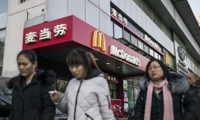 Công ty Trung Quốc cấm nhân viên dùng iPhone, xe hơi và gà rán Mỹ - Ảnh 1.