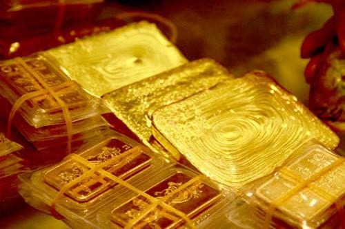 Giá vàng hôm nay 31/5, dồn dập mua USD đẩy vàng xuống đáy - Ảnh 1.