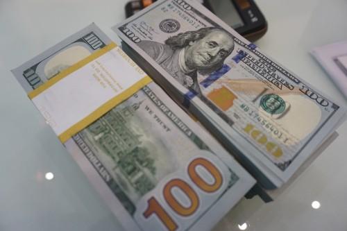 Tại sao tỉ giá ngân hàng cao hơn thị trường tự do? - Ảnh 1.