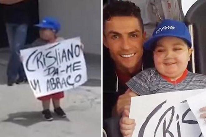 Ronaldo dừng xe buýt để đáp lại tình cảm CĐV nhí - Ảnh 1.