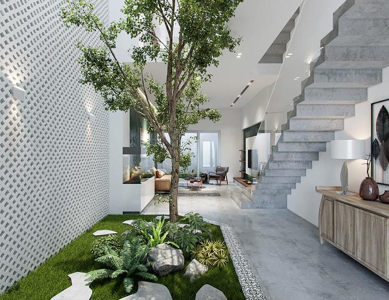 Nhà đẹp với giếng trời và nội thất ngập tràn sắc xanh - Ảnh 2.