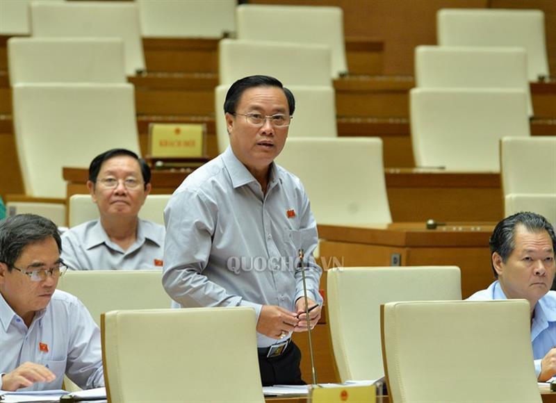 Bị chất vấn có dám cam kết hoàn thành cao tốc Trung Lương - Mỹ Thuận, Bộ trưởng GTVT nói gì? - Ảnh 1.