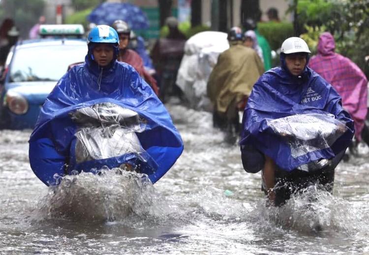 Miền Bắc tuần tới mưa giông, miền Trung nắng nóng - Ảnh 1.