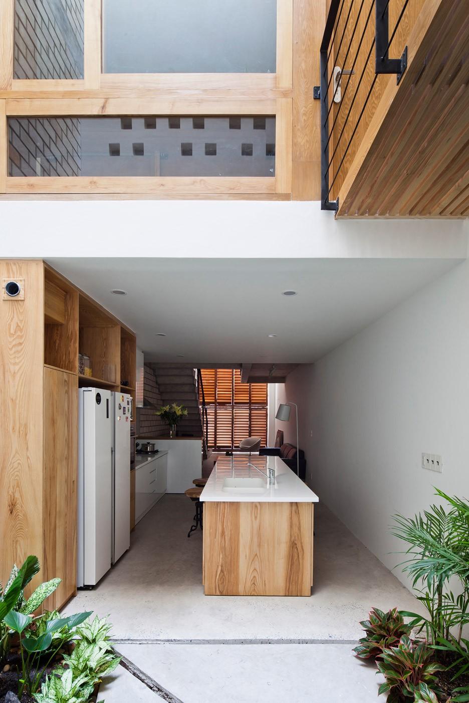 Townhouse-with-a-folding-up-shutter_Vietnam_MM-Architects_dezeen_936_7