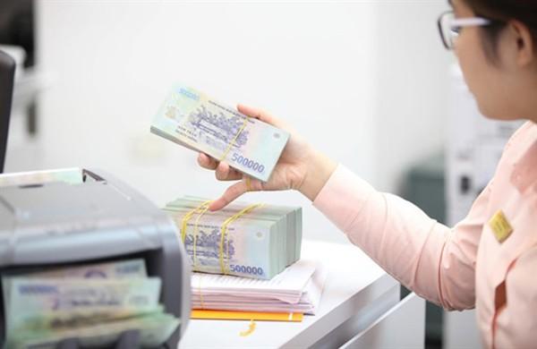 Ngân hàng Nhà nước hạ lãi suất điều hành - Ảnh 2.