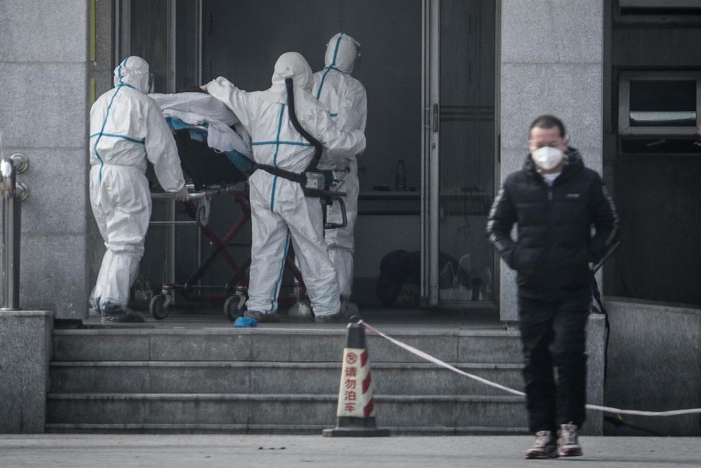 Virus corona - cú đòn choáng váng đánh vào kinh tế Trung Quốc - Ảnh 1.