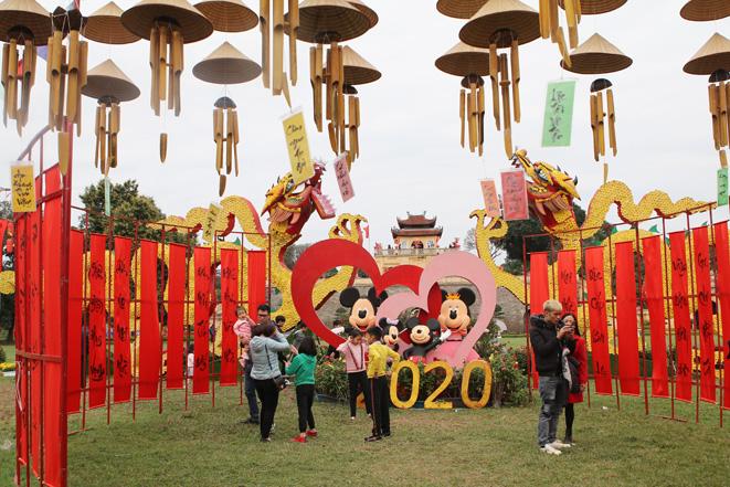 Các điểm vui chơi ở Thủ đô tấp nập khách ngày Tết - Ảnh 7.