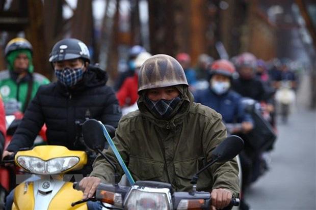 Thủ đô Hà Nội rét đậm, vùng núi cao có khả năng xảy ra băng giá - Ảnh 1.