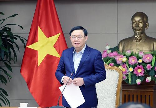 Phó Thủ tướng yêu cầu giá heo hơi phải giảm về 45.000-50.000 đồng/kg trong vài tháng tới - Ảnh 1.