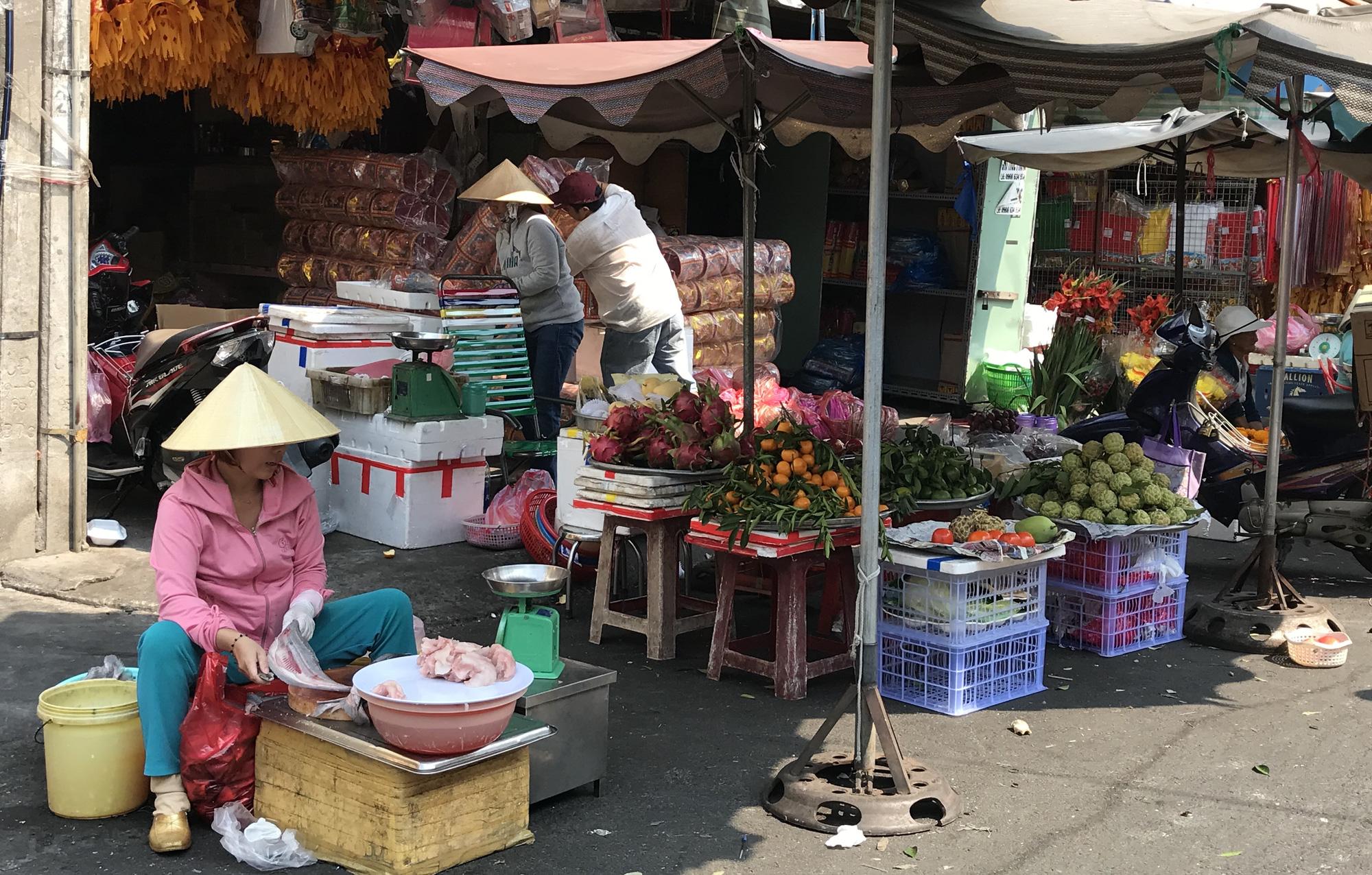 Hàng quán Sài Gòn còn ăn Tết, đóng cửa im ỉm, chưa khai trương dù đã bước qua mùng 7 - Ảnh 10.