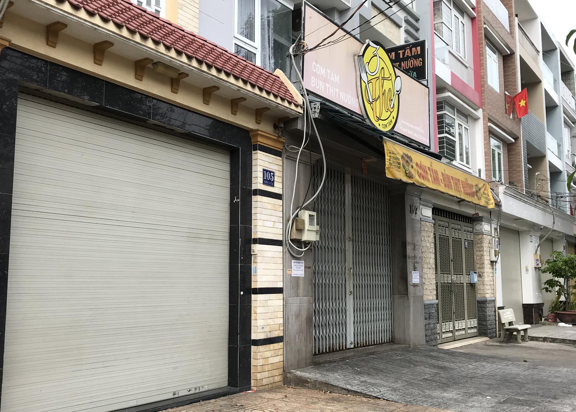 Hàng quán Sài Gòn còn ăn Tết, đóng cửa im ỉm, chưa khai trương dù đã bước qua mùng 7 - Ảnh 1.