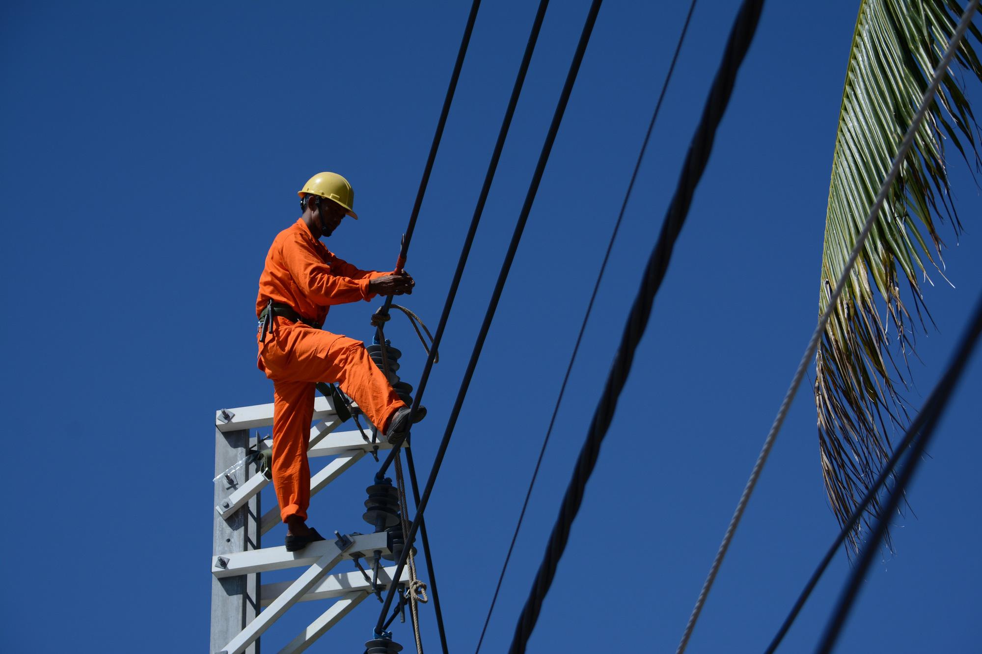 Việt Nam sẽ nhập gần 1,5 tỉ kWh điện từ Lào mỗi năm - Ảnh 1.