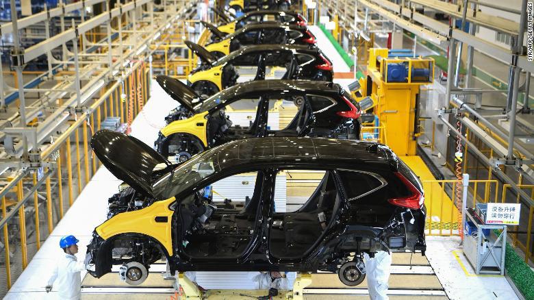 Virus corona làm tê liệt ngành sản xuất ô tô toàn cầu - Ảnh 1.