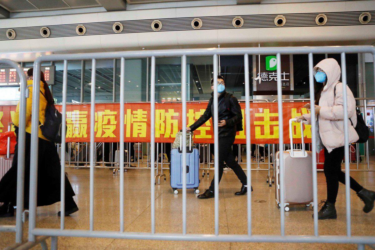 Người dân Trung Quốc đang trở lại làm việc sau Tết như thế nào trong mùa dịch corona? - Ảnh 1.