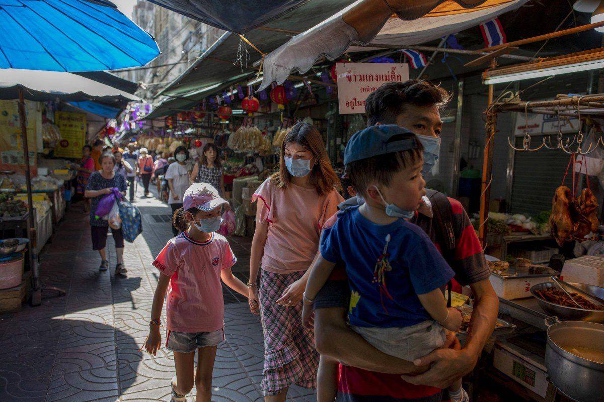 Các nền kinh tế châu Á điêu đứng vì virus corona - Ảnh 1.