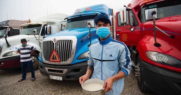 Thủ tướng yêu cầu tài xế phải mặc đồ bảo hộ khi chở nông sản lên cửa khẩu để phòng virus corona - Ảnh 1.
